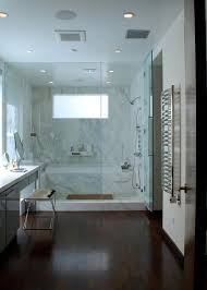 walk in shower with marble bathtub