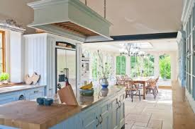 Gloucestershire kitchen conservatory extension provides a light filled  space for dining