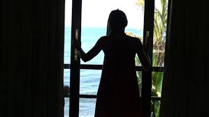 silhouette of woman opening door and walking out on terrace super slow motion royalty