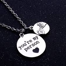 celebrate the family with a touch of flair this inspirational pendant necklace features a two tone design inscribed with the words the love of family