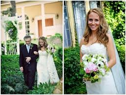 father of the bride walks beautiful bride in white strapless wedding dress