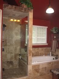 Walk in shower with frameless shower door, and travertine tile  mediterranean-bathroom
