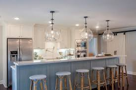 glass light fixtures are a great way to add a little drama to a room especially in small spaces adding glass pendants in a small kitchen for example