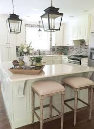 Classic Charleston Style Farmhouse Kitchen with brick backsplash, painted  island and lantern pendant lights |
