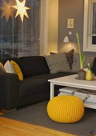 black furniture wall color. love the gray wall color goes well with black couch purple furniture