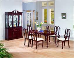 the oval dining table set includes a table side chairs arm chairs and a hutch buffet