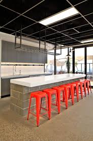 The Bold Collective | Traffik | Kitchen Breakout: open ceiling grid, black  ceiling,