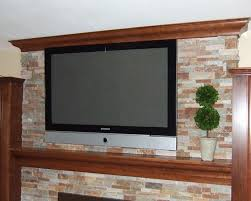 hand crafted mantel crown molding stone fireplace surround and cabinets by ecostruction llc custommade com