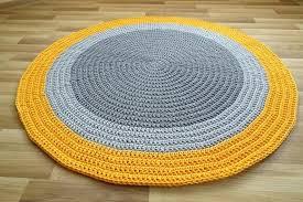 yellow round rug image 0 and white ikea brick road runner orange