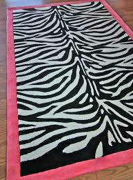 image of pink zebra rug with black color