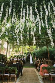 samantha and tony s haiku mill wedding is nothing short of a tropical fairy tale with strings of white petals hanging from above an abundance of greenery