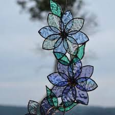 stained glass hummingbird suncatcher window ornaments on rhinestone flower centres blown pattern