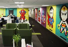 notes the employees volunteered to e into work on the weekend and install a series of 8 bit portraits of our favourite superheroes and ic book