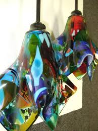 we created three very unique and colorful fused glass pendant lights for our client in the outer banks of north ina the lights are multiple layers of