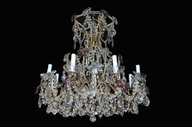 an exquisite vintage french crystal chandelier having eight lights on scrolled bronze beaded crystal arms a glass and bronze shaft on swags