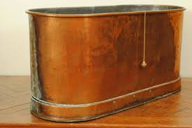 german neoclassical copper and zinc lined bathtub for of oval form and of two piece construction the bottom plinth with a wooden