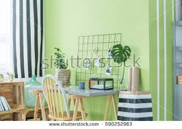 green home office. simple home home office with green plants desk chair and metal accessories to green office
