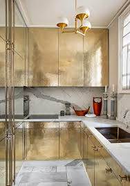 So did you catch that mention of brass - all over the brass hardware and  fixtures mixed with the Calcatta for both kitchens and baths. Check it out.
