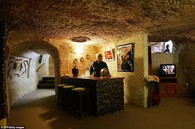 judy mclean displays the dimly lit subterranean bar and lounge of faye s underground house