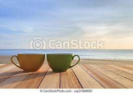 Actually you should start every day here with a beautiful sunrise! Coffee Cup On Wood Table At Sunset Or Sunrise Beach Close Up Coffee Cup On Wood Table At Sunset Or Sunrise Beach Canstock