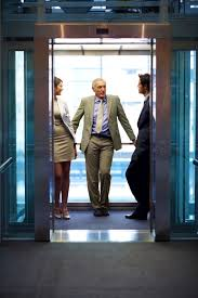 the marketing message you re probably neglecting bb technology successful business people standing in office elevator and talking each other