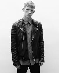 black and white campaign image of a man wearing a black leather biker jacket over a