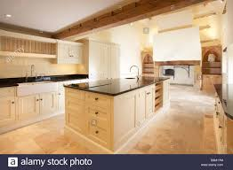 Limestone Flooring In Kitchen Modern Cream Quaker Style Kitchen In Old House With Inglenook