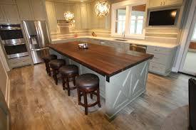 butcher block kitchen island with seating on hardwood floor
