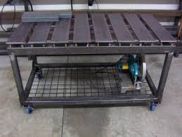 neat idea for a plasma cutting cart all the slag and dust funnels down to the bucket pirate4x4 is another great source for fab projects
