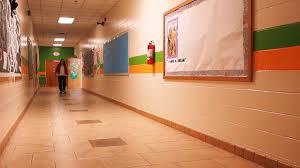 hallway at school. teacher walking down school hallway at e