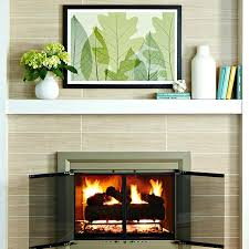 tile fireplace makeover fireplace with new tile surround and doors diy tile fireplace makeover