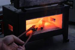 forging metal. tongs hot metal forge forging