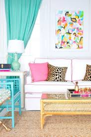 Colorful living room with white sofa (with pink piping) and turquoise  bamboo chairs plus matching turquoise drapes. Love the mix of pillows with  leopard and ...