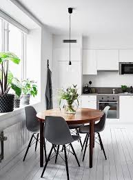 white kitchen with a round dining table via coco lapine design