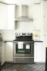 white shaker kitchen cabinets grey floor. Grey Floor, Black Granite Counters, Off White Cabinets. Kitchen Remodel: IKEA Cabinets And Range Hood, Honed Countertops, Penny Tile Shaker Floor