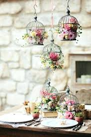 bird cage decoration small bird cages with bold fl arrangements on the table and hung over