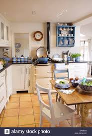 simple country kitchen. Beautiful Country White Painted Chairs At Simple Wood Table In White Country Kitchen With  Cream Aga And Terracotta Tiled Floor In Simple Country Kitchen E