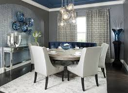 view in gallery contemporary dining room with a splash of blue gray and a light colored rug