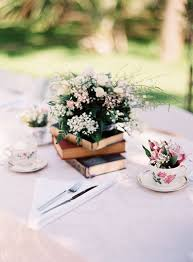 flower arrangements on a stand of vine books photo by gabeaceves