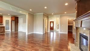 open floor plan hardwood flooring living room kitchen shutterstock 176526584