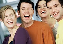 four people smiling and choosing to be happy at work