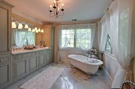 traditional master bathroom with cast iron clawfoot tub and carrara marble counter