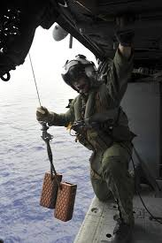 Naval Aircrewman Conducts A Search And Rescue Drill On An Mh 60s Sea Hawk Photographic Print By Art Com