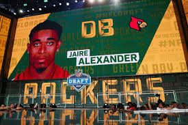 board displays an image of jaire alexander of louisville after he was picked 18 overall by the green bay packers during the first round of the 2018 nfl