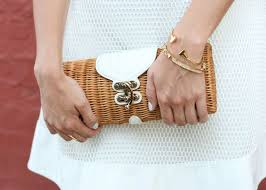 white textured a line dress with basket clutch and park lane jewelry