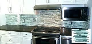 blue glass tile backsplash blue glass tile stainless chimney hood stacked cabinets