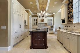 white cabinets dark tile floors. elegant traditional kitchen in luxury home with white cabinets, dark cabinet island and double sinks cabinets tile floors t