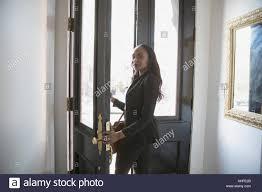 Businesswoman walking through her front door Stock Photo 165682787