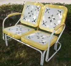 metal retro glider in yellow and white
