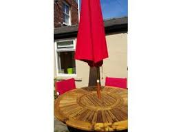 garden table and chairs for sale in leeds. round solid wood garden table, 6 chairs and parasol table for sale in leeds